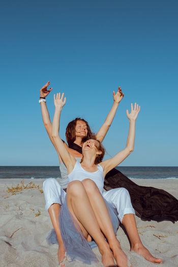 Close-up of women embracing at beach