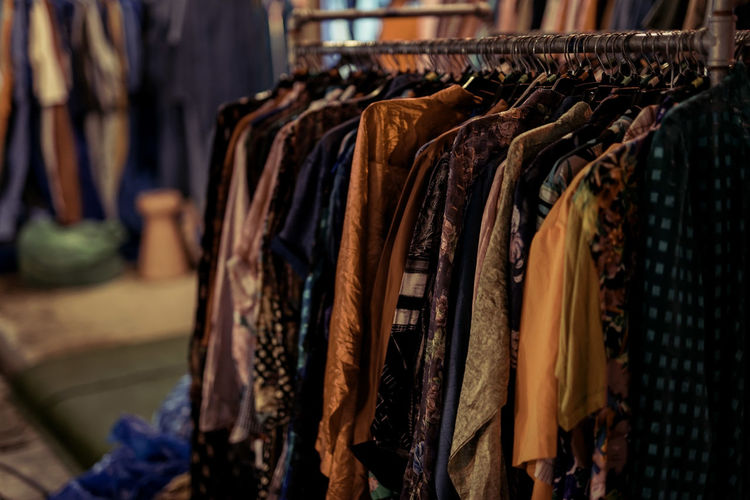 Clothes hanging in store for sale at market