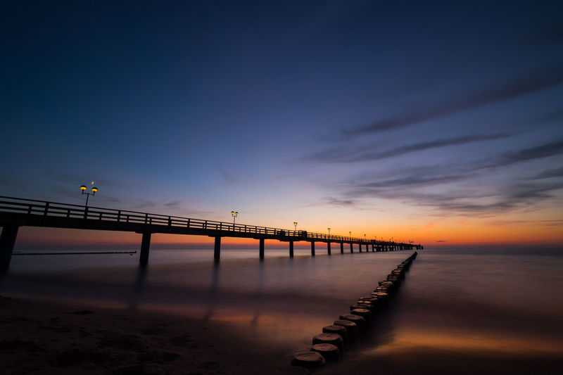 Architecture Beach Beauty In Nature Bridge Bridge - Man Made Structure Built Structure Cloud - Sky Connection Horizon Over Water Idyllic Nature No People Orange Color Outdoors Pier Scenics - Nature Sea Sky Sunset Tranquil Scene Tranquility Water