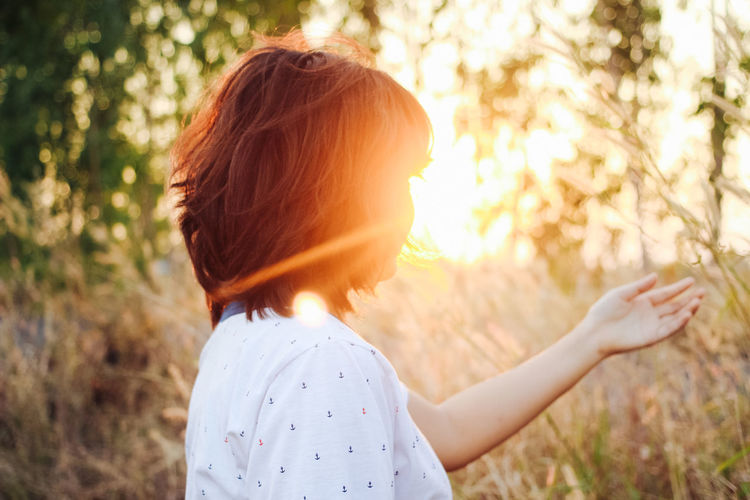 woman give her hand EyeEm Best Shots EyeEm Nature Lover Beauty In Nature Casual Clothing Day Field Focus On Foreground Forest Growth Leisure Activity Lifestyles Long Hair Nature One Person Outdoors People Real People Rear View Standing Sunlight Sunset Tree Women Young Adult Young Women