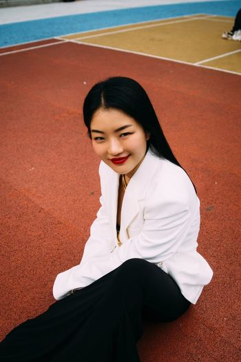 One Person Young Women Young Adult Lifestyles Leisure Activity Real People Women Adult Smiling Beauty Sitting High Angle View Front View Portrait Day White Color Clothing Beautiful Woman Hairstyle Asian Girl