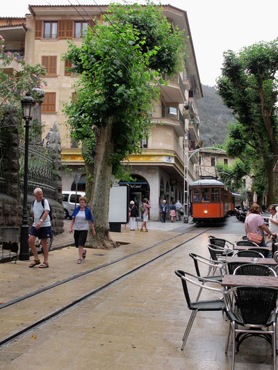 old town part of Soller with its cable car tram driving. aside restaurant. Soller, Mallorca Soller History Mallorca Mallorca💙 Mallorca🌞 Town Traveling Cable Car Built Structur City City Life City Street Street Transportation Urban