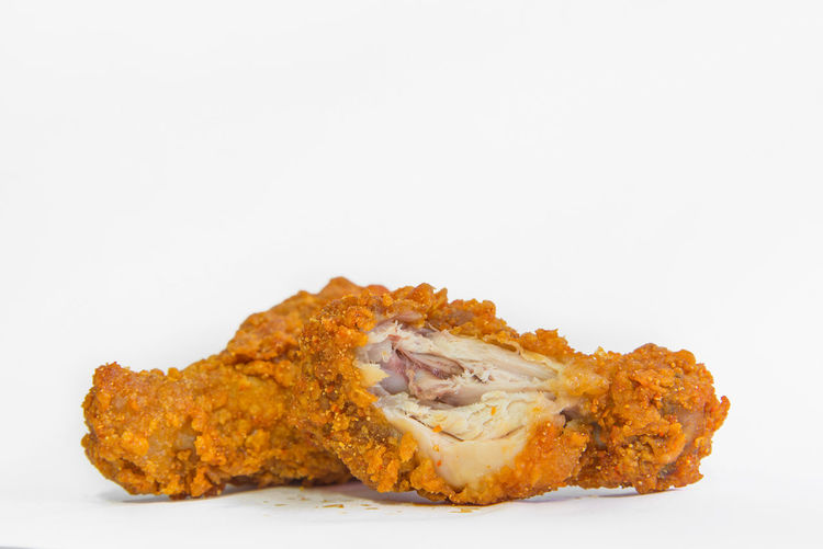 Studio Shot White Background Indoors  Copy Space Food And Drink Close-up Food Freshness No People Still Life Cut Out Ready-to-eat Orange Color Fried Single Object Unhealthy Eating Meat Baked Chicken Meat Sweet Food Snack Fried Chicken Temptation