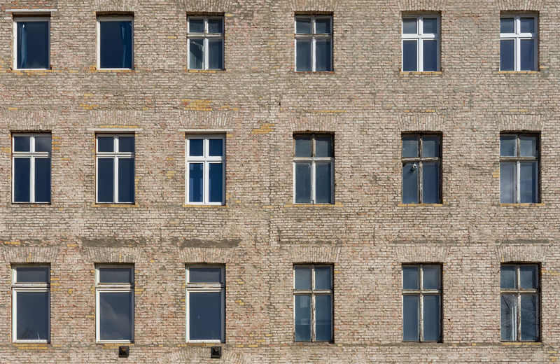 Urban Façade Residential District Residential Building Old Empty Bust  Brick Abandoned Abandoned Buildings Window Built Structure Architecture Full Frame Building Exterior Backgrounds No People Building In A Row Side By Side Repetition Outdoors Day Wall Pattern Glass - Material The Past Design History