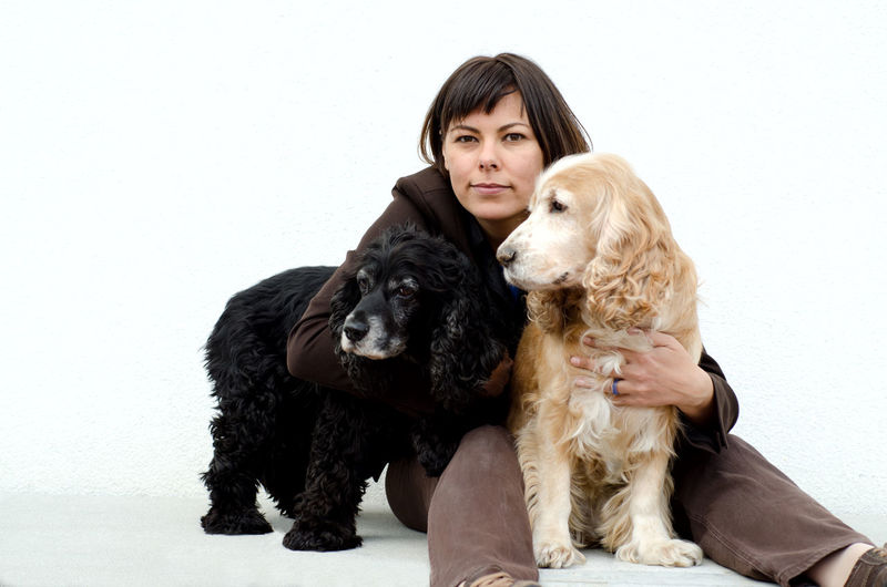 Woman hugging her two dogs Adults Only Beautiful People Beautiful Woman Beauty Bonding Cocker Spaniel  Color Cute Day Dog Domestic Animals Friendship Hugging Looking At Camera Love Only Women People Pets Portrait Togetherness Two Dogs White Background Women Young Adult Young Women