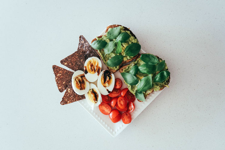 Healthy food Avocado Toast  Diet Food And Drink Toast Vegeterian Food Food Freshness Gourmet Healthy Eating High Angle View Ready-to-eat Studio Shot Vegan Food White Background