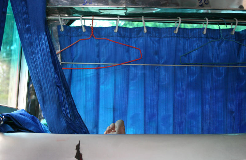 On the road in Thailand... EyeEmNewHere Backseat Blue Bus Close-up Clotheshanger Curtain Day Indoors  Toe