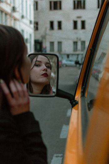 Reflection of woman on car window