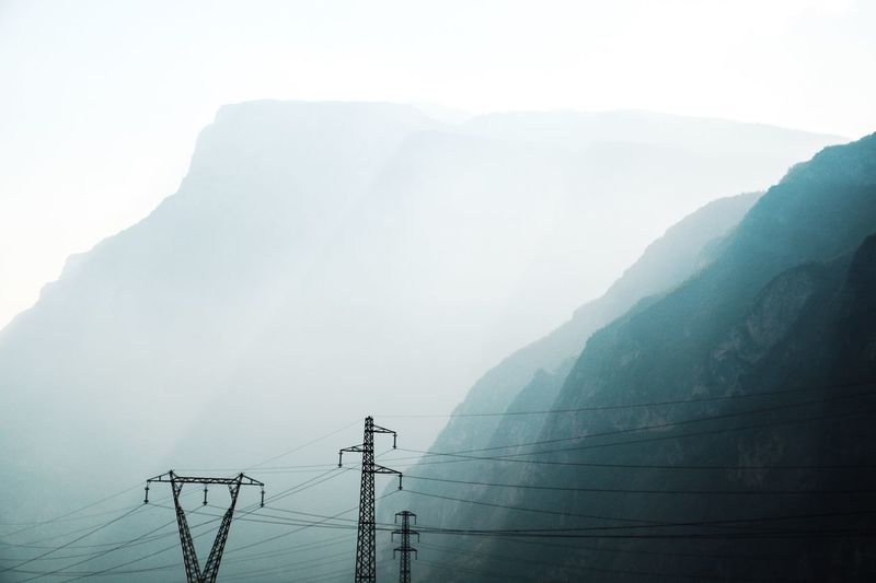Beauty In Nature Electricity  Electricity Pylon Fog Foggy Mountain Mountain Range Nature
