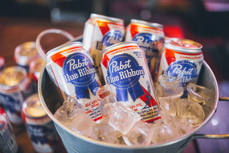 Beer Bucket Dixie Beer Dixie Pabst Blue Ribbon Bar Neon Neon Lights Food And Drink Food Close-up Retail  Still Life Container Focus On Foreground Text No People For Sale Variation Choice Transparent Label Plastic Selective Focus Freshness Day Indoors  Animal