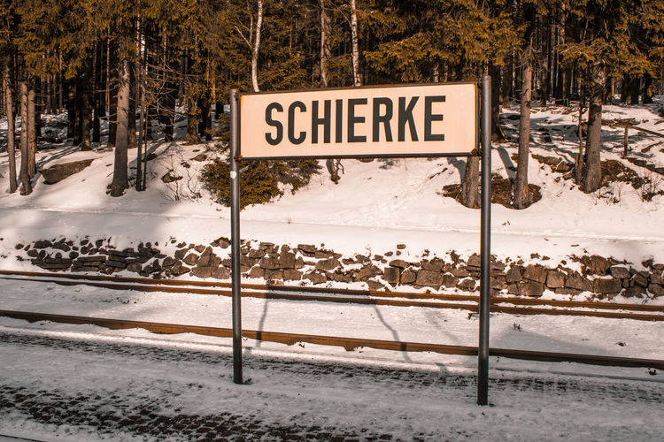 train station sign of Schierke train station at Harz Mountains National Park, Germany Germany Harz Harzmountains National Park Nature Outdoors Winter Snow Forest Schierke Train Station Platform Sign Train Stop Village Place Famous Place Vintage Variation Holiday Travel Travel Destinations Cold Temperature Tree Communication Text Western Script Information Information Sign Frozen Plant No People Land Day Road Capital Letter Covering Guidance Snowcapped Mountain