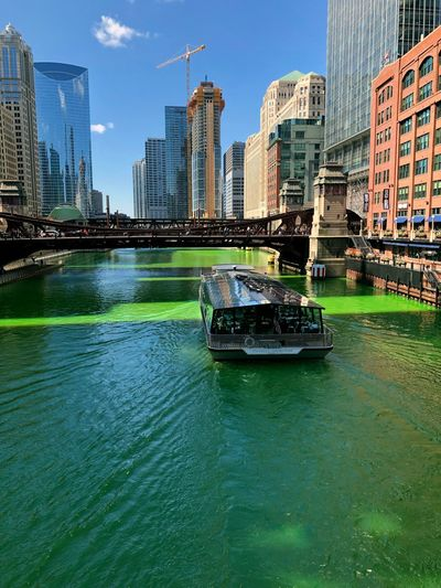 Touring on the green river Chicago St Patrick's Day Built Structure Building Exterior Architecture Water Nautical Vessel City Transportation Building Waterfront Mode Of Transportation Office Building Exterior Day Skyscraper Tower City Cityscape Urban Skyline Urban Green Green Color Tourism Tourist Destination Travel Travel Destinations Passenger Craft Office Tall - High River