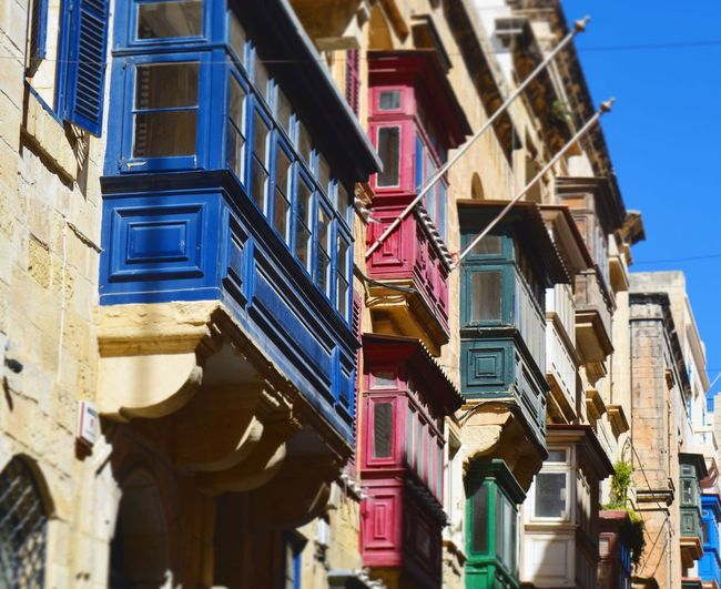 Be different EyeEm Diversity Balcony Malta Valletta Views City Streets Windows Colours Different Perspective Difference  Variation Art Architecture Houses Holidays Picoftheday Travel Destinations Travel Photography Low Angle View Outdoors Built Structure Blue Red Green