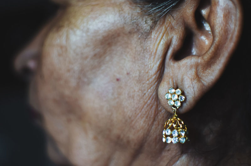 Cropped Image Of Mature Woman Wearing Diamond Earring