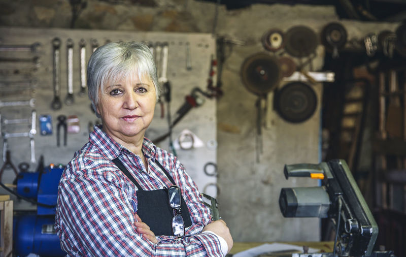 Portrait of woman standing in workshop