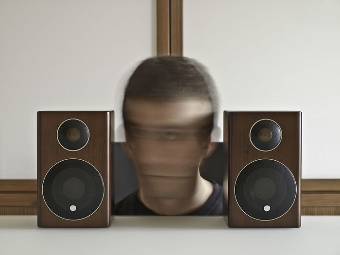 Man scrolling his head between loudspeakers Circle Close Up Close-up Container Control Directly Above HEAD Holding Home Home Interior Ideas Indoors  Listening Music Loudspeakers Music Musical Equipment Old-fashioned Part Of Scrolling Shaking Shaking My Head Single Object Still Life Studio Shot Table Technology