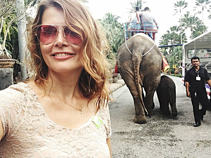 Family Of Elephants Elephant Sunglasses Adult Day Young Adult Outdoors Togetherness Front View Adults Only Smiling Young Women Looking At Camera Domestic Animals Portrait