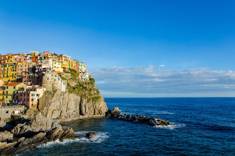Scenic view of cinque terre against sky