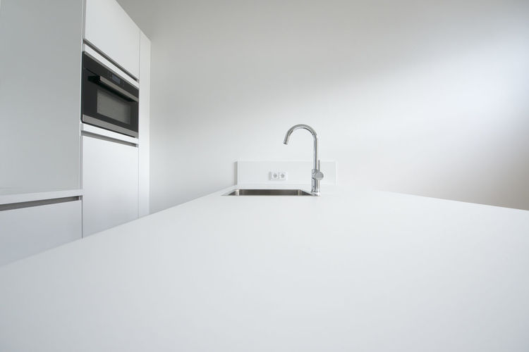 Indoors  Copy Space White Color Architecture No People Absence Wall - Building Feature Home Modern Built Structure Domestic Room Empty Building Sink Household Equipment Simplicity Window Day Table Bathroom Apartment