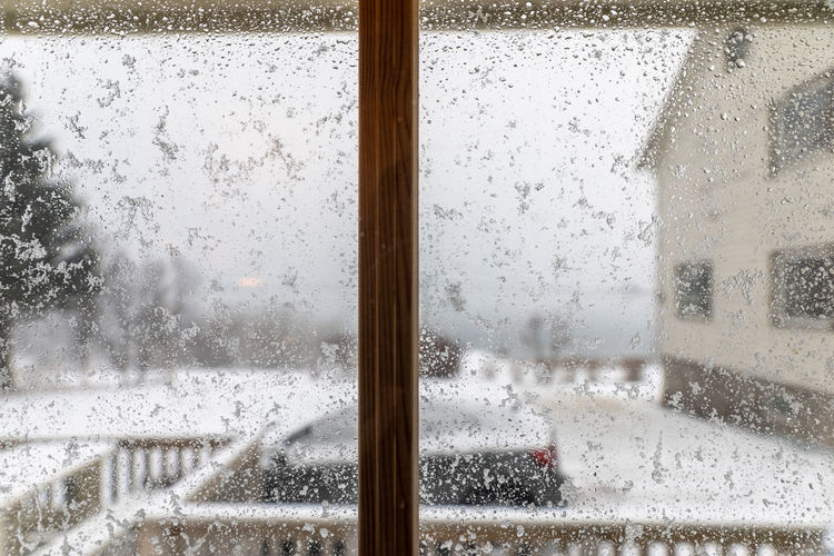 Norway Northern Norway Nordland Lofoten Lofoten Islands Snow Snowing Storm Thunderstorm Winter Cosy Inside Warm Glass - Material Window Transparent Wet Water Drop Indoors  Rain Nature No People Focus On Foreground Car Transportation Day Close-up Architecture RainDrop Glass Rainy Season Window Frame