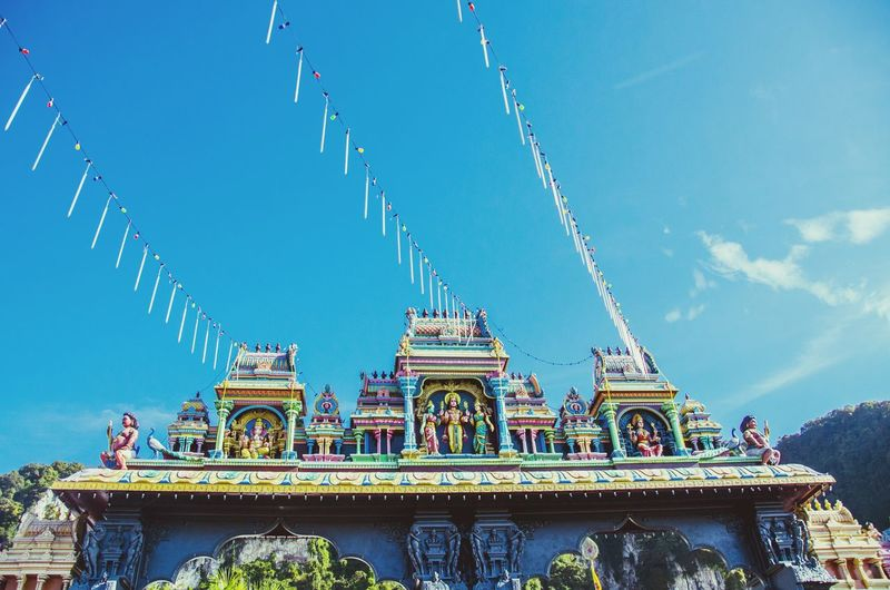 Low angle view of temple against sky at batu caves
