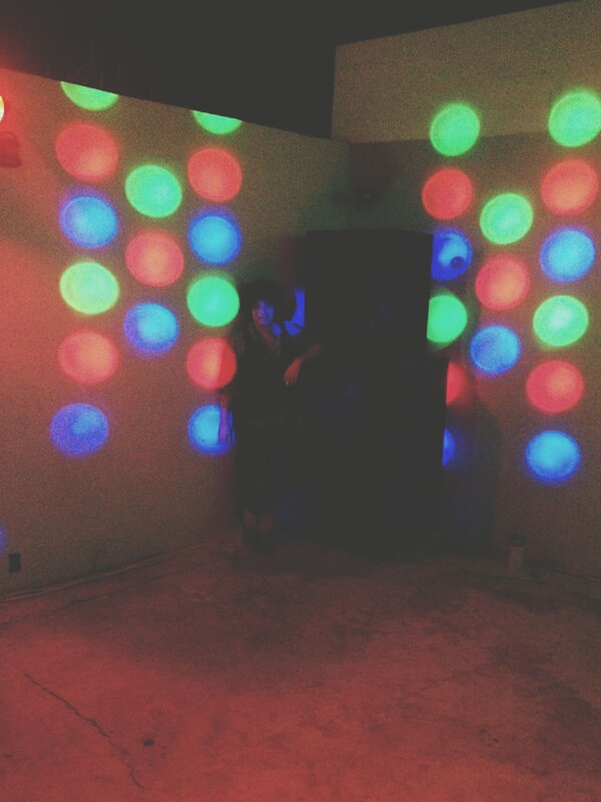 illuminated, night, lighting equipment, multi colored, indoors, light - natural phenomenon, glowing, electric light, no people, light, colorful, defocused, built structure, electricity, decoration, wall - building feature, circle, architecture, red, lit
