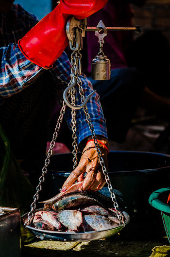 Market Chain Close-up Day Fish Fishing Fishing Industry Focus On Foreground Food Food And Drink Freshness Hanging Market Meat Nautical Vessel One Person Preparation  Raw Food Real People Retail  Rope Seafood