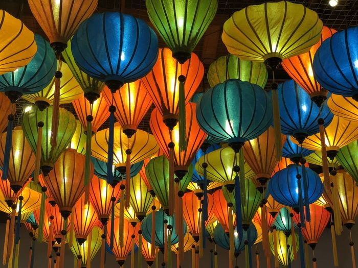 Low Angle View Of Illuminated Lanterns For Sale In Store