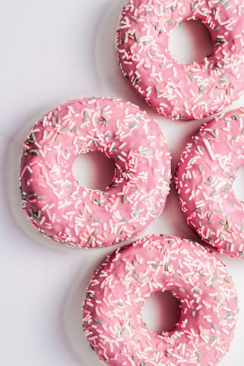 High angle view of pink donuts on table
