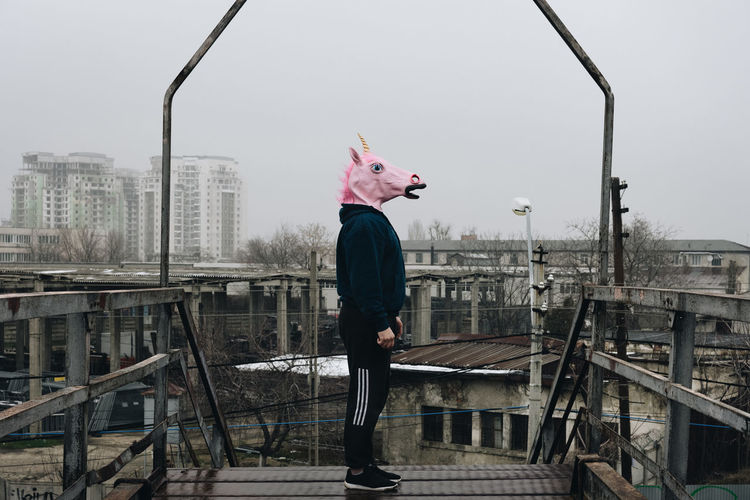 Unicorns will save the construction industry. Pink Abandoned Abandoned Buildings Urbex Unicorn Unicorn Head Unicorn Mask One Man Only Disguise Mask Mask - Disguise Construction Construction Site Building Buildings Urban Damaged One Person Adult Adults Only People Standing Day Outdoors Full Length City Sky Press For Progress Colour Your Horizn