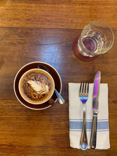 Table Drink Food And Drink Refreshment Eating Utensil Kitchen Utensil Coffee Still Life Coffee - Drink Wood - Material Freshness Spoon Indoors  Directly Above Cup Coffee Cup No People Mug Fork Food