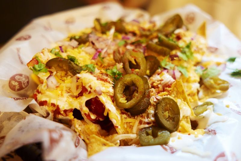 Close-Up Of Nachos On Paper