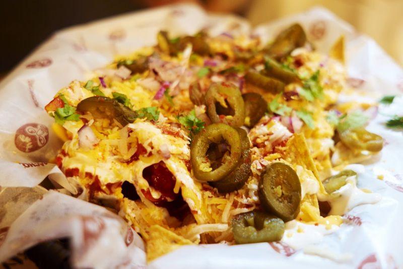 Close-up of nachos on paper