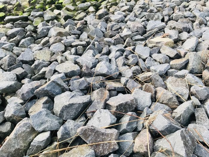 Full Frame Backgrounds Day Nature No People Solid Sunlight Textured  Rock Pattern High Angle View Stone - Object Land Abundance Outdoors Large Group Of Objects Close-up Rock - Object Beach Stone