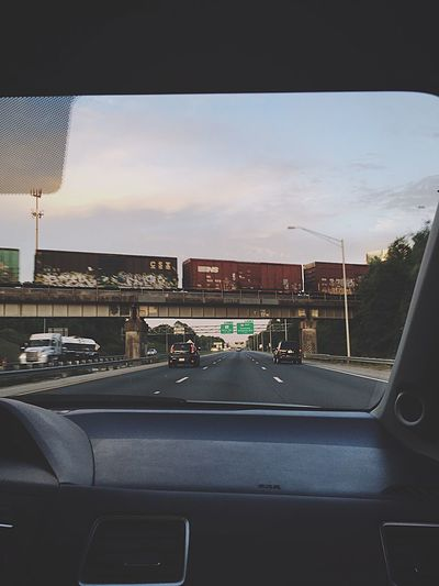 Car Transportation Vehicle Interior Road Interstate Travel Dashboard Sky Windshield Afternoon Sunset Clouds Car Point Of View Built Structure No People Day The Street Photographer - 2017 EyeEm Awards EyeEmNewHere