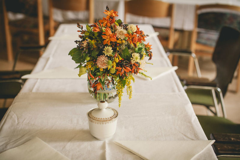 Celebration Wedding Arrangement Bouquet Bunch Of Flowers Cafe Chair Decoration Dining Table Flower Flower Arrangement Flower Head Flowering Plant Focus On Foreground Freshness Furniture Home Interior Indoors  Nature No People Plant Seat Setting Table Vase