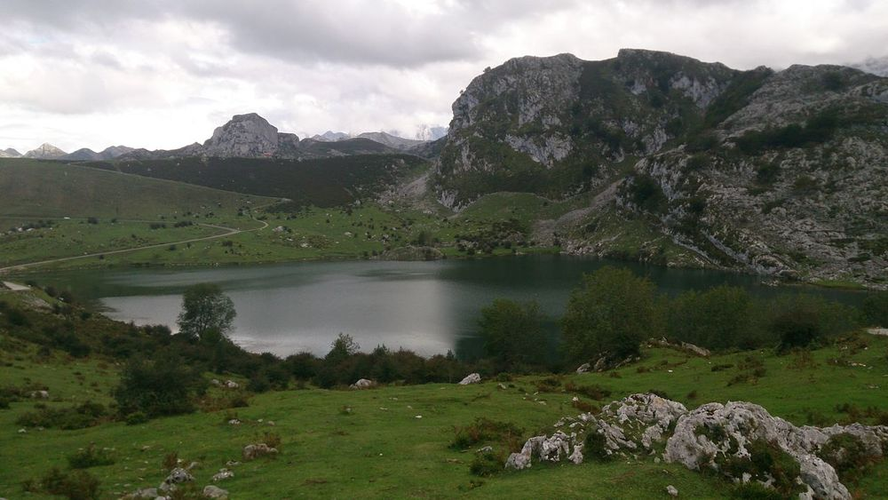 Lake Enol in Asturias Beauty In Nature Cloud Cloud - Sky Cloudy Countryside Day Grass Green Color Growth Hill Idyllic Landscape Mountain Mountain Range Nature No People Non Urban Scene Non-urban Scene Outdoors Remote Scenics Sky Tranquil Scene Tranquility Valley