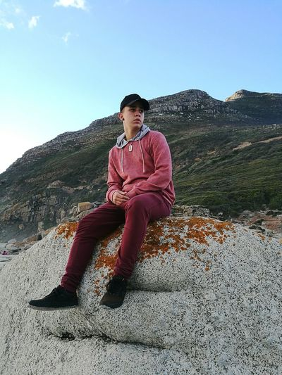 EyeEmNewHere Young Adult Nature Mountain Outdoors Sky Child Day One Person Teenager Sitting Teenagers Only Model Pose Fashion Rock Rock - Object Rocky Mountains Photgraphy Followme Pose Model Ocean Beach Nature Casual Clothing Full Length