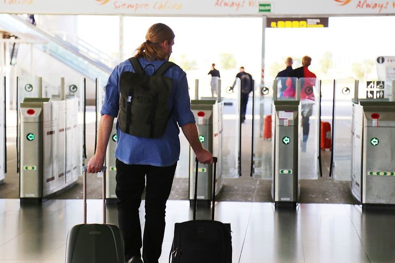 Travel Destination Gateway Gates Tourism Arrival Gates Arrival Terminal Arrival Hall Arriving Arrival Departure Board Airport Travel Luggage Indoors  Transportation Airport Suitcase Journey Mode Of Transportation One Person Passenger Adult Gate Standing Airport Departure Area Business Finance And Industry Young Adult Men Airport Check-in Counter Leaving Arrival