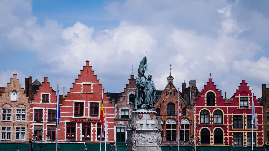 Panoramic view of buildings in city against sky. bruges
