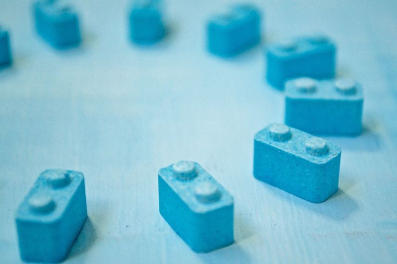 High angle view of blue block candies on table