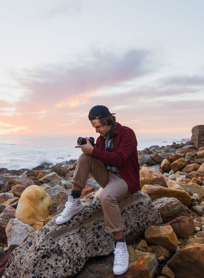 Sunset mission -brother Beach Photography Themes Sea Rock - Object One Person Wireless Technology Sky Sunset Leisure Activity Standing Smart Phone Nature Portable Information Device Cloud - Sky Photographing Looking Down South Africa Outdoors Lifestyles Technology Be. Ready. EyeEm Gallery EyeEm Selects EyeEm Best Shots The Week On EyeEm Be. Ready.