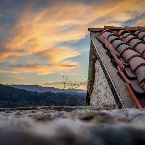 Close-Up Of Roof Against Sky During Sunset