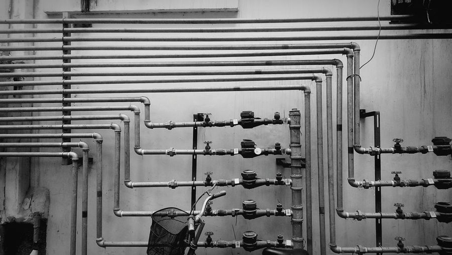 Water pipes against wall