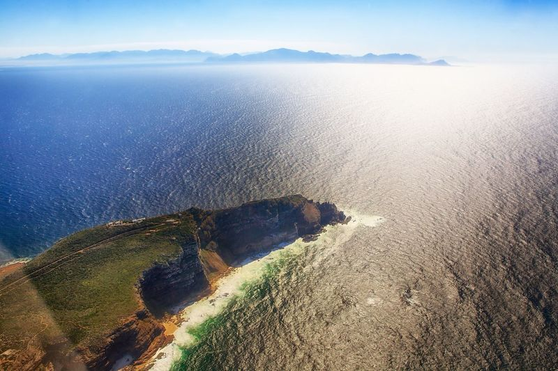 Cape Of Good Hope Bay Helicopter Cape Of Good Hope Kap Der Guten Hoffnung Capetown South Africa Beauty In Nature Water Tranquility Scenics - Nature Sea Tranquil Scene Land Nature Non-urban Scene Outdoors Mountain Sky