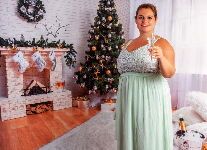 Full length of woman on christmas tree