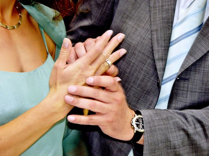 Close-up of man holding hand