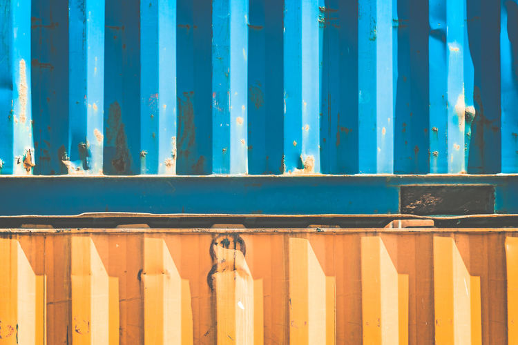 Architecture Backgrounds Blue Building Exterior Built Structure Cargo Container Close-up Container Corrugated Day Full Frame In A Row Metal Nature No People Outdoors Pattern Side By Side Sunlight Turquoise Colored Wall - Building Feature Wood - Material