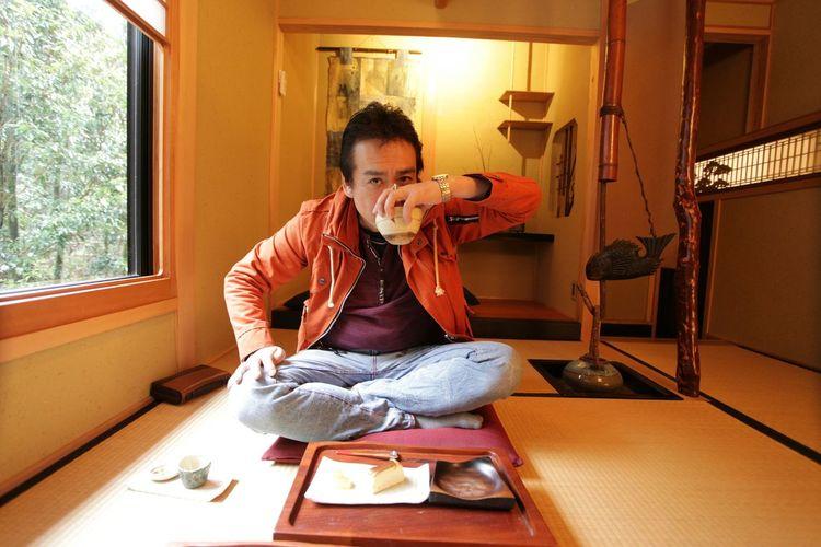 Portrait of man drinking tea