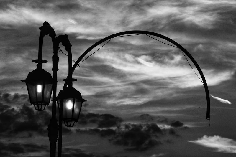 Sky Cloud - Sky Sky Lighting Equipment Street Light Illuminated Hanging Nature No People Dusk Low Angle View Outdoors Street Metal Light Night Focus On Foreground Electric Lamp Retro Styled